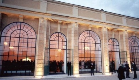 The Orangery Vienna during an event, view from the outside. The audience is inside while some are stretching their legs