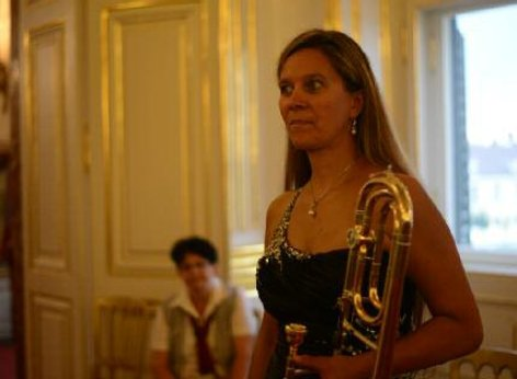 A musician of the Schoenbrunn Palace concerts on her way to the concert, instrument in hand