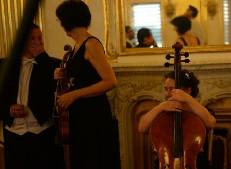 The musicians of the Schoenbrunn Palace Orchestra during the break, waiting in the Schoenbrunn Orangery