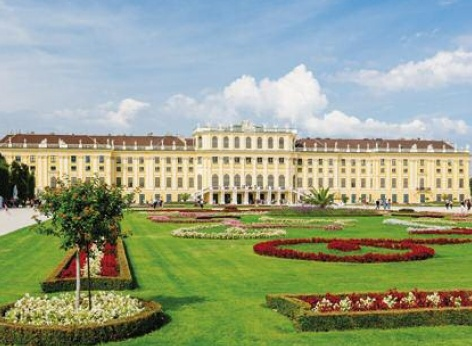 The beautifully arranged garden of Schoenbrunn Palace in springtime with lavish flower arrangements in the park